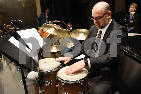 Percussionist Roland Muzquiz warms up with the East Texas Symphony Orchestra during an event with Tyler ISD fourth and fifth graders called The Orchestra Sings Tuesday Jan. 31, 2017 at Caldwell Auditorium.  (Sarah A. Miller/Tyler Morning Telegraph)
