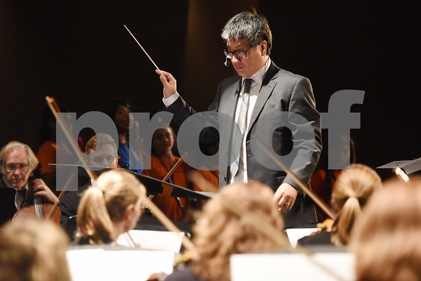 Richard Lee conducts the East Texas Symphony Orchestra during an event with Tyler ISD fourth and fifth graders called The Orchestra Sings Tuesday Jan. 31, 2017 at Caldwell Auditorium.  (Sarah A. Miller/Tyler Morning Telegraph)