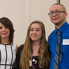 Laura O'Kane (left) presents Jasmine McGillicuddy (center) of Ayer-Shirley Regional HS and Jacob DeCarolis of Leominster HS with DiGeronimo Family Scholarships at the North Central Mass Chamber of Commerce Scholarship Breakfast at the Doubletree in Leominster. SENTINEL & ENTERPRISE / Jim Marabello