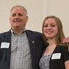 Jim Adams (left) presents Hannah Burns of Leominster HS with the Adams Family Scholarship at the North Central Mass Chamber of Commerce Scholarship Breakfast at the Doubletree in Leominster. SENTINEL & ENTERPRISE / Jim Marabello