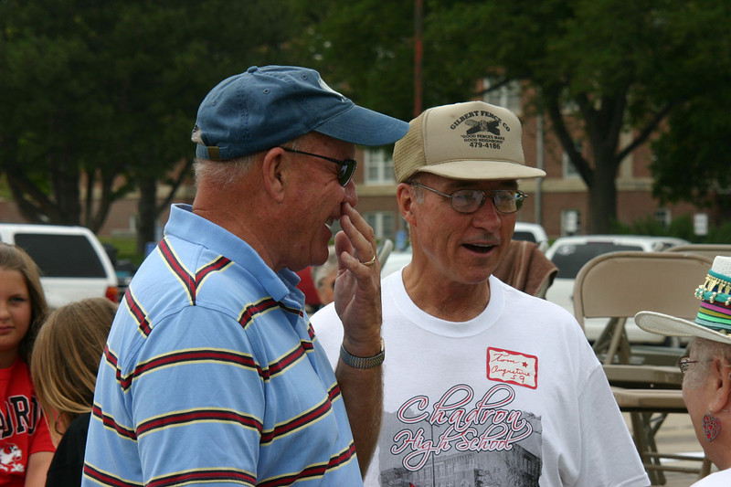 A pre-parade conversation includes Ralph Byerly of Chandler, Arizona and Tom Augustine of Cleveland, Tennessee