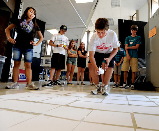 "New Fairview freshman, Chance Ubel, plays a freshman orientaion game with a group of new freshman at Fairview High School on Wednesday.<br /> For a video and more photos of Fairview, go to  <a href=""http://www.dailycamera.com"">http://www.dailycamera.com</a>.<br /> Cliff Grassmick  / August 15, 2012"