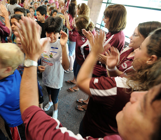 """New 6th-grader, Grace Colin, left center, prepares to high five Principal, Mike Medina, during the first day of school at Angevine Middle School in Lafayette.<br /> For a video at Angevine, go to  <a href=""""http://www.dailycamera.com"""">http://www.dailycamera.com</a>.<br /> Cliff Grassmick  / August 15, 2012"""