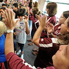 "New 6th-grader, Grace Colin, left center, prepares to high five Principal, Mike Medina, during the first day of school at Angevine Middle School in Lafayette.<br /> For a video at Angevine, go to  <a href=""http://www.dailycamera.com"">http://www.dailycamera.com</a>.<br /> Cliff Grassmick  / August 15, 2012"