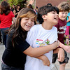 "Sixth-grader, Vanessa Gonzalez, left, has a big welcome hug for classmate, Grace Colin, during the first day of School at Angevine Middle School in Lafayette.<br /> For a video at Angevine, go to  <a href=""http://www.dailycamera.com"">http://www.dailycamera.com</a>.<br /> Cliff Grassmick  / August 15, 2012"