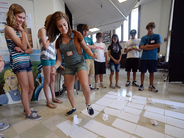 "New Fairview freshman, Eleni Vlachos, plays a freshman orientation game with a group of new freshman at Fairview High School on Wednesday.<br /> For a video and more photos of Fairview, go to  <a href=""http://www.dailycamera.com"">http://www.dailycamera.com</a>.<br /> Cliff Grassmick  / August 15, 2012"