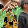 "Ian Munding, a new 6th-grader, travels through a welcome tunnel of 8th-graders  during the first day of school at Angevine Middle School in Lafayette on Wednesday.<br /> For a video at Angevine, go to  <a href=""http://www.dailycamera.com"">http://www.dailycamera.com</a>.<br /> Cliff Grassmick  / August 15, 2012"