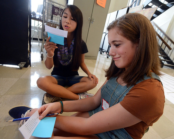 "New Fairview freshman, Ellie Toray, reads questions to classmate, Eleni Vlachos during a freshman orientation exercise at Fairview High School on Wednesday.<br /> For a video and more photos of Fairview, go to  <a href=""http://www.dailycamera.com"">http://www.dailycamera.com</a>.<br /> Cliff Grassmick  / August 15, 2012"