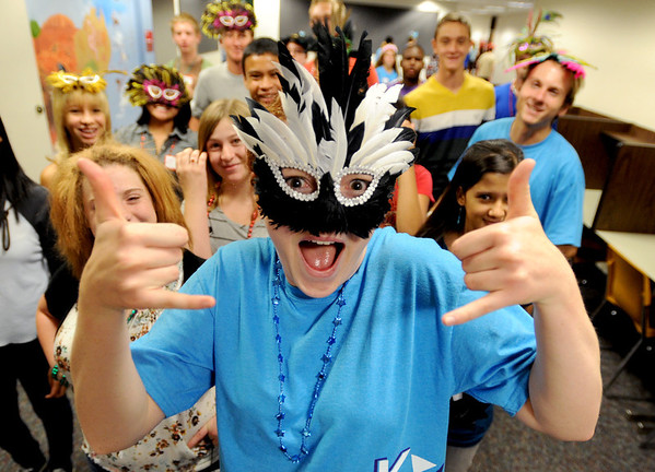 """Katie Kowal, center,  a Fairview upperclassman, gives a tour of the school during the freshman orientation to Fairview High School on Wednesday.<br /> For a video and more photos of Fairview, go to  <a href=""""http://www.dailycamera.com"""">http://www.dailycamera.com</a>.<br /> Cliff Grassmick  / August 15, 2012"""