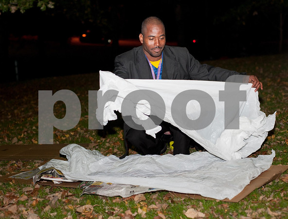 Alfred White of Tyler sets up a makeshift bed to sleep outside at Bergfeld Park in Tyler, Texas during the annual One Night Without A Home event Thursday Nov. 12, 2015. Participants in the event spend the night at the park to give them a better idea of life as a homeless person.   (Sarah A. Miller/Tyler Morning Telegraph)