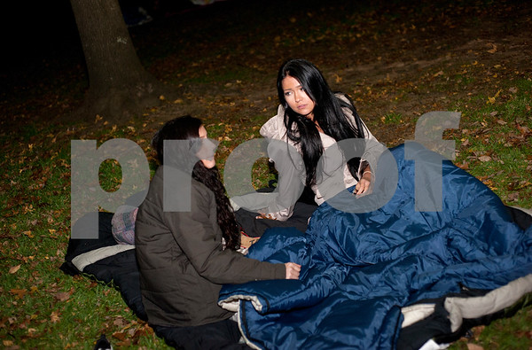 Tyler Junior College students Olivia Martin and Erin Blaine talk before sleeping outside at Bergfeld Park in Tyler, Texas during the annual One Night Without A Home event Thursday Nov. 12, 2015. Participants in the event spend the night at the park to give them a better idea of life as a homeless person.   (Sarah A. Miller/Tyler Morning Telegraph)
