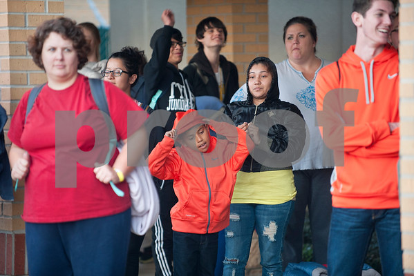 Crystal Felix of Tyler and her son Juan Felix, 8, wait at The Salvation Army to start their walk to Bergfeld Park in Tyler, Texas for the annual One Night Without A Home event Thursday Nov. 12, 2015. Participants in the event spend the night at the park to give them a better idea of life as a homeless person.   (Sarah A. Miller/Tyler Morning Telegraph)