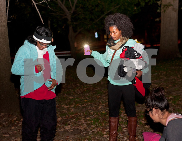 Esther Emanuel puts a warm jacket on with help from Samaria Johnson as they prepare to go to sleep outside at Bergfeld Park in Tyler, Texas during the annual One Night Without A Home event Thursday Nov. 12, 2015. Participants in the event spend the night at the park to give them a better idea of life as a homeless person.   (Sarah A. Miller/Tyler Morning Telegraph)