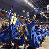 Graduates toss their caps into the air at the end of Saturday's Broomfield High School Commencement at the 1stBank Center.<br /> May 19, 2012 <br /> staff photo/ David R. Jennings