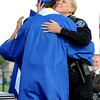 "Lafayette police officer, Wendy Stogner, hugs Kyle Peterson after getting the Gastellum Award.<br /> For more photos and a video of  Centaurus graduation, go to  <a href=""http://www.dailycamera.com"">http://www.dailycamera.com</a>.<br /> Cliff Grassmick / May 19, 2012"