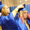 "Morie Jurdem, left, helps Hailey Smith with her cap on Saturday.<br /> For more photos and a video of Peak to Peak graduation, go to  <a href=""http://www.dailycamera.com"">http://www.dailycamera.com</a>.<br /> Cliff Grassmick / May 19, 2012"