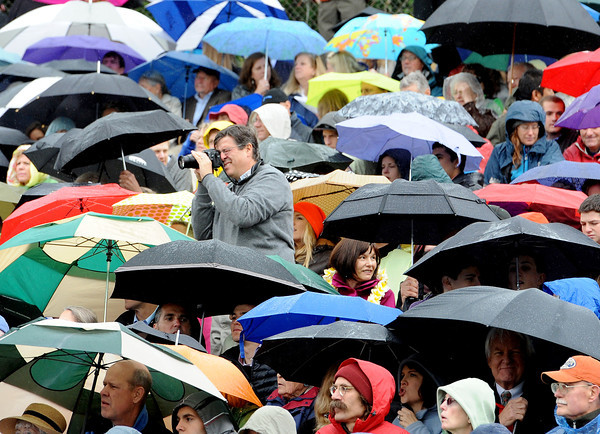 "Family and friends braved the rain to capture the moments of Boulder High graduation.<br /> For more photos and a video of BHS graduation, go to  <a href=""http://www.dailycamera.com"">http://www.dailycamera.com</a>.<br /> Cliff Grassmick / May 19, 2012"