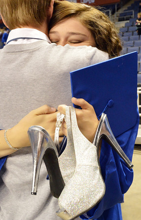Abby Kochevar hugs a friend after Saturday's Broomfield High School Commencement at the 1stBank Center.<br /> <br /> May 19, 2012 <br /> staff photo/ David R. Jennings
