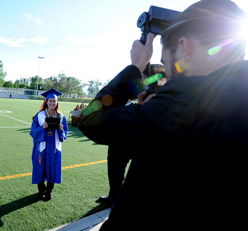 "McKenna Asakawa gets her photo taken with her new Centaurus diploma.<br /> For more photos and a video of  Centaurus graduation, go to  <a href=""http://www.dailycamera.com"">http://www.dailycamera.com</a>.<br /> Cliff Grassmick / May 19, 2012"