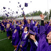 "Abel Brown, bottom right, joined his fellow Boulder High classmates in throwing up their caps at the end of the ceremony on Saturday.<br /> For more photos and a video of BHS graduation, go to  <a href=""http://www.dailycamera.com"">http://www.dailycamera.com</a>.<br /> Cliff Grassmick / May 19, 2012"