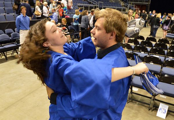 be0524Broomgrad07A.jpg Abby Kochevar hugs Zane Garcia after Saturday's Broomfield High School Commencement at the 1stBank Center.<br /> <br /> May 19, 2012 <br /> staff photo/ David R. Jennings