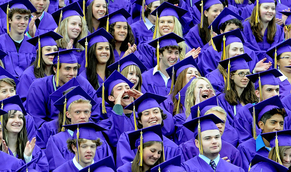 "Boulder High School seniors listen to graduation speakers Saturday morning in the rain.<br /> For more photos and a video of BHS graduation, go to  <a href=""http://www.dailycamera.com"">http://www.dailycamera.com</a>.<br /> Cliff Grassmick / May 19, 2012"