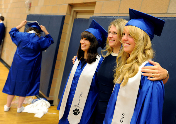 """Christine O'Malley, left, her mom, Lanna, and sister, Savannah, pose for  a special photo on Saturday.<br /> For more photos and a video of Peak to Peak graduation, go to  <a href=""""http://www.dailycamera.com"""">http://www.dailycamera.com</a>.<br /> Cliff Grassmick / May 19, 2012"""