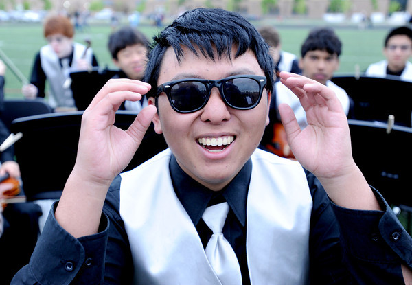 "Kevin Li plays violin in the Peak to Peak band, so he needs to look cool.<br /> For more photos and a video of Peak to Peak graduation, go to  <a href=""http://www.dailycamera.com"">http://www.dailycamera.com</a>.<br /> Cliff Grassmick / May 19, 2012"