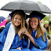 "Elizabeth McJannet-Bratton, left, and Lea Maxwell, share an umbrella during the Peak to Peak graduation on Saturday.<br /> For more photos and a video of Peak to Peak graduation, go to  <a href=""http://www.dailycamera.com"">http://www.dailycamera.com</a>.<br /> Cliff Grassmick / May 19, 2012"