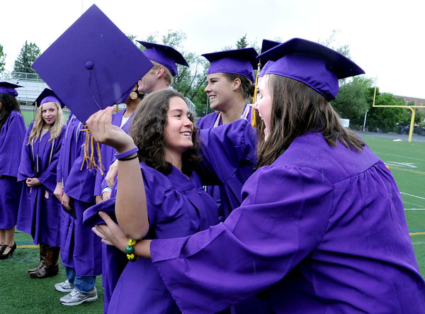 "Megan Lancaster-Cavallo, left, has a hug for A.J. McColluch after getting her diploma from Boulder High.<br /> For more photos and a video of BHS graduation, go to  <a href=""http://www.dailycamera.com"">http://www.dailycamera.com</a>.<br /> Cliff Grassmick / May 19, 2012"
