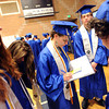 "Cass Madden, center, is signing a Peak to Peak yearbook before the graduation ceremony.<br /> For more photos and a video of Peak to Peak graduation, go to  <a href=""http://www.dailycamera.com"">http://www.dailycamera.com</a>.<br /> Cliff Grassmick / May 19, 2012"