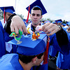 "Austin Wand helps Adrian Villasenor  get his tassel over his decorations.<br /> For more photos and a video of  Centaurus graduation, go to  <a href=""http://www.dailycamera.com"">http://www.dailycamera.com</a>.<br /> Cliff Grassmick / May 19, 2012"