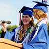 "McKenna Asakawa, left, braces for microphone feedback noise before speaking with Megan Valentine.<br /> For more photos and a video of  Centaurus graduation, go to  <a href=""http://www.dailycamera.com"">http://www.dailycamera.com</a>.<br /> Cliff Grassmick / May 19, 2012"