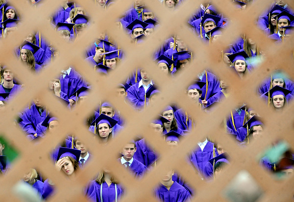 "Boulder High School seniors listen to graduation speakers as seen through the lattice of the stage.<br /> For more photos and a video of BHS graduation, go to  <a href=""http://www.dailycamera.com"">http://www.dailycamera.com</a>.<br /> Cliff Grassmick / May 19, 2012"