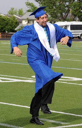 "Ben Grodsky has a bounce in his step as he heads to Centaurus graduation.<br /> For more photos and a video of  Centaurus graduation, go to  <a href=""http://www.dailycamera.com"">http://www.dailycamera.com</a>.<br /> Cliff Grassmick / May 19, 2012"