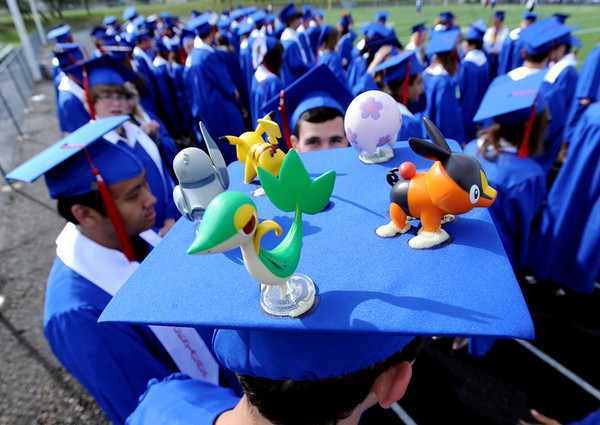 "Adrian Villasenor pulled out all the stops on his cap decoration on Saturday.<br /> For more photos and a video of  Centaurus graduation, go to  <a href=""http://www.dailycamera.com"">http://www.dailycamera.com</a>.<br /> Cliff Grassmick / May 19, 2012"