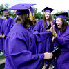 "Carley McColluch, left, is about to be hugged by A.J. McColluch after receiving her diploma form Boulder High  on Saturday.<br /> For more photos and a video of BHS graduation, go to  <a href=""http://www.dailycamera.com"">http://www.dailycamera.com</a>.<br /> Cliff Grassmick / May 19, 2012"