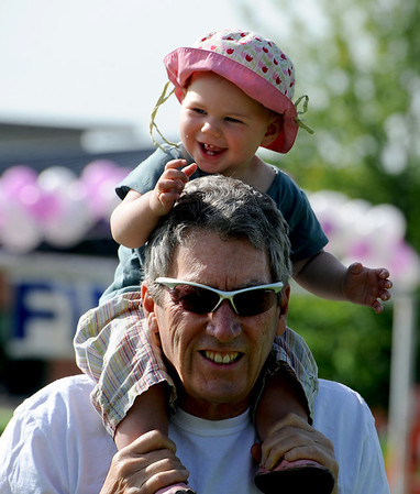 "Bill Allen gives his granddaughter, Elsie Paine, 1, a lift over to the start of the Columbine Mile. Race. <br /> About 450 students  participated in 35th Annual Columbine Elementary School Mile Marathon on Friday. For more photos and a video of the run, go to  <a href=""http://www.dailycamera.com"">http://www.dailycamera.com</a>.<br /> Cliff Grassmick / May 18, 2012"
