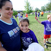 "Rosa Barron, left, has a hug for her daughter, Paola Garcia, after  Paola finished the race.<br />  About 450 students  participated in 35th Annual Columbine Elementary School Mile Marathon on Friday. For more photos and a video of the run, go to  <a href=""http://www.dailycamera.com"">http://www.dailycamera.com</a>.<br /> Cliff Grassmick / May 18, 2012"