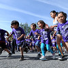 "One  of the waves of the Columbine Mile takes off outside the school.<br />  About 450 students  participated in 35th Annual Columbine Elementary School Mile Marathon on Friday. For more photos and a video of the run, go to  <a href=""http://www.dailycamera.com"">http://www.dailycamera.com</a>.<br /> Cliff Grassmick / May 18, 2012"