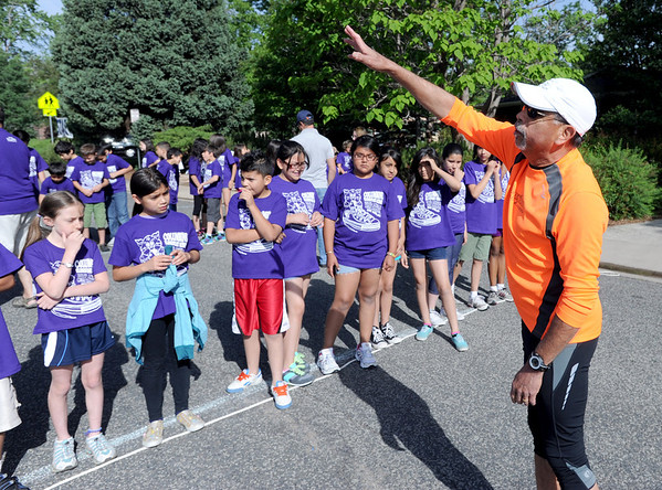 "Rich Castro, right, gives the runners a pep talk before the race.<br />  About 450 students  participated in 35th Annual Columbine Elementary School Mile Marathon on Friday. For more photos and a video of the run, go to  <a href=""http://www.dailycamera.com"">http://www.dailycamera.com</a>.<br /> Cliff Grassmick / May 18, 2012"