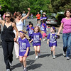 "Parents, staff and students, finish up the Columbine Mile Marathon. <br /> About 450 students  participated in 35th Annual Columbine Elementary School Mile Marathon on Friday. For more photos and a video of the run, go to  <a href=""http://www.dailycamera.com"">http://www.dailycamera.com</a>.<br /> Cliff Grassmick / May 18, 2012"