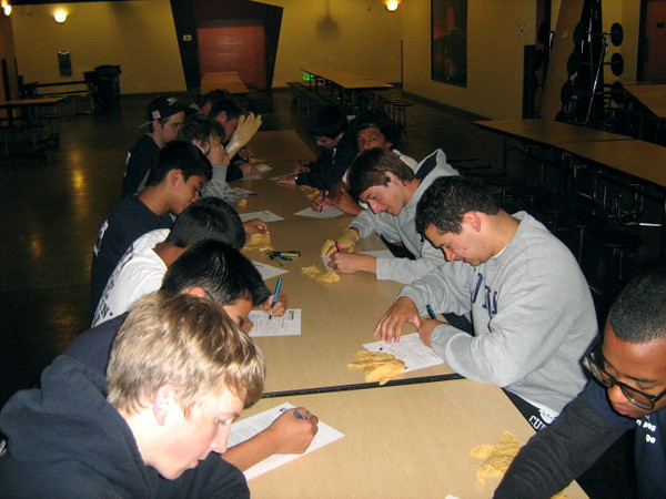 Boys sign in to work the breakfast shift at the Midnight Mission on Saturday, May 26th, 2012