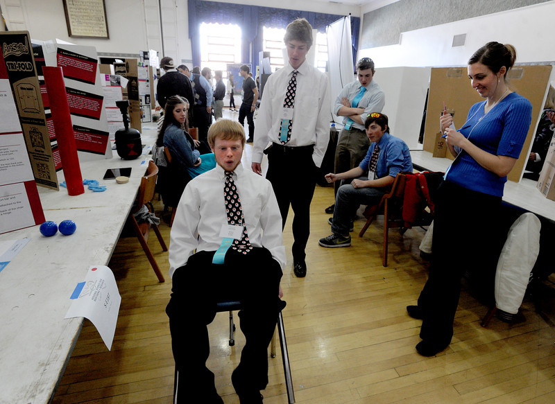 "William Rowsam, left, of Centaurus High School, demonstrates how his lean back chair device works as judge Ashley Pennington looks on.<br /> Boulder Valley School District held their regional science fair at the Glenn Miller Ballroom at CU on Thursday.<br />  For  a video and more photos of the fair, go to  <a href=""http://www.dailycamera.com"">http://www.dailycamera.com</a>. <br />  Cliff Grassmick  / February 28, 2013"