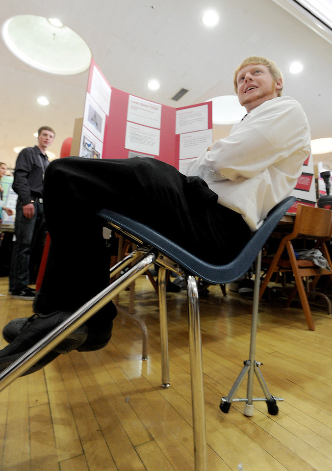 """William Rowsam of Centaurus High School, demonstrates how his lean back chair device works.<br /> Boulder Valley School District held their regional science fair at the Glenn Miller Ballroom at CU on Thursday.<br />  For  a video and more photos of the fair, go to  <a href=""""http://www.dailycamera.com"""">http://www.dailycamera.com</a>. <br />  Cliff Grassmick  / February 28, 2013"""
