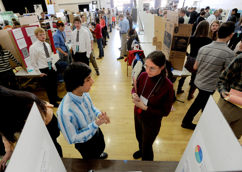 "Mahyar Mansurabadi, explains his project to judge Suzanne Gallagher during the senior judging.<br /> Boulder Valley School District held their regional science fair at the Glenn Miller Ballroom at CU on Thursday.<br />  For  a video and more photos of the fair, go to  <a href=""http://www.dailycamera.com"">http://www.dailycamera.com</a>. <br />  Cliff Grassmick  / February 28, 2013"