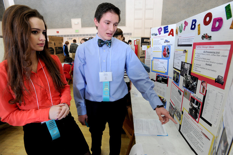 """Meghan Doherty, left, and John Kern, both from Centaurus High School, talk about their project on peanut biodiesel.<br /> Boulder Valley School District held their regional science fair at the Glenn Miller Ballroom at CU on Thursday.<br />  For  a video and more photos of the fair, go to  <a href=""""http://www.dailycamera.com"""">http://www.dailycamera.com</a>. <br />  Cliff Grassmick  / February 28, 2013"""