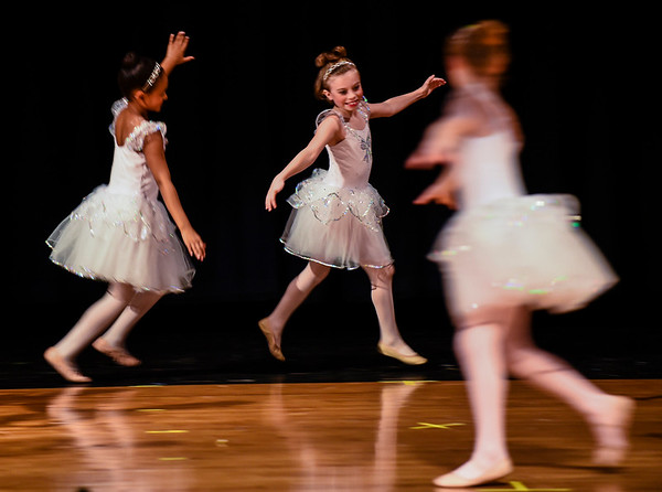 Students of Amanda Browning's ballet class perform the Waltz of the Snowflakes during the Holiday Showcase put on by Motion Studios at Scribner Middle School in New Albany on Saturday afternoon. Staff photo by Tyler Stewart