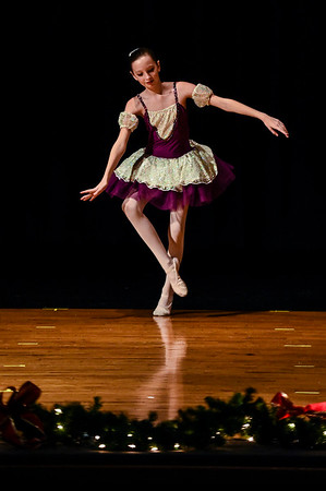 Junior Ballet member Keira Bordenkircher performs her routine for Sugar Plum during the Motion Studio's Holiday Showcase at Scribner Middle School on Saturday afternoon. Staff photo by Tyler Stewart