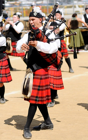 Don Knight | The Herald Bulletin<br /> Jonas Craib performs a bagpipe solo as The Marching Highlanders from Anderson High School perform at State Fair Band Day on Saturday.